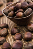 Group of Fresh Chestnuts on Wooden Background Royalty Free Stock Photography