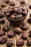 Group of Fresh Chestnuts on Wooden Background Stock Photography