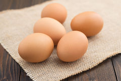 Group of fresh chicken eggs on napkin.  Royalty Free Stock Photography