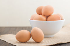 Group of fresh chicken eggs in white bowl.  Royalty Free Stock Image