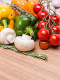 Group fresh colored vegetables on wooden Stock Image