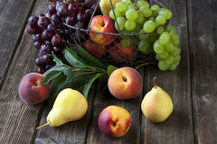 Group of fresh fruits on wood background Stock Photography