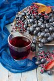 Grape on wooden table. Group of fresh  grape  and juice in glass Royalty Free Stock Photography