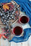 Grape on wooden table. Group of fresh  grape  and juice in glass Royalty Free Stock Photo