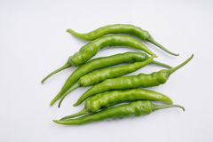 Group of fresh green chili peppers isolated on white background royalty free stock image