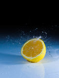 Group of fresh lemon cut on glasses table to movement. Stock Images
