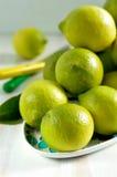 Group of fresh lemons. Fresh lemons on the color plate Royalty Free Stock Photography