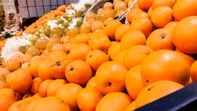 Group of fresh organic oranges in a marketplace Royalty Free Stock Image