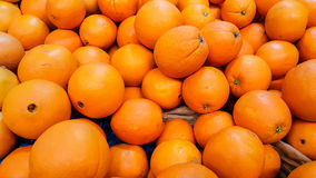 Group of fresh organic oranges in a marketplace royalty free stock photography