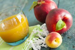 Group of fresh peaches and juice on vintage wooden Royalty Free Stock Photos