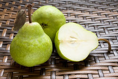Group Of Fresh Pears With One Halved Stock Photos