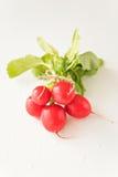 Group of fresh radishes on white background. Image of group of fresh radishes Royalty Free Stock Photos