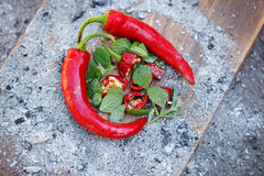 Group of fresh red hot chilli peppers on an old vintage wooden table Royalty Free Stock Image