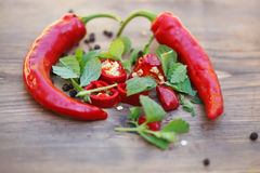 Group of fresh red hot chilli peppers on an old vintage wooden table Stock Photos