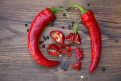 Group of fresh red hot chilli peppers on an old vintage wooden table Royalty Free Stock Photo