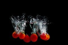 Tomato in water splash Stock Image