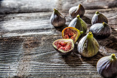 Group of fresh ripe figs on genuine table background Stock Image