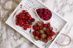 Group of fresh s fruits together cherries,raspberries and strawb. Erries. Cherries in white bowl.Strawberry, cherries,raspberries on a wooden background. Top Stock Photo