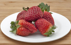 Strawberries pile stock images