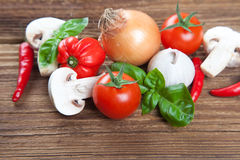 Group of fresh vegetables and herbs on old wood Royalty Free Stock Photography