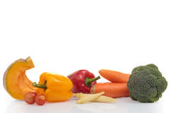 Group of fresh vegetables on white . Stock Photos