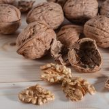Organic walnuts. A Group of freshly picked walnuts on a table Royalty Free Stock Photos