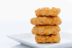 Group of fried chicken nuggets. On white dish Royalty Free Stock Images