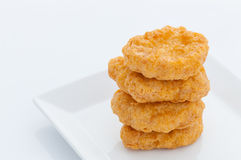 Group of fried chicken nuggets. On white dish Royalty Free Stock Image