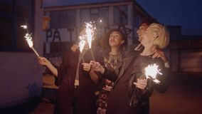 Group of friend enjoying with sparklers on city street stock footage