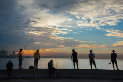 Group of friend fishing at Malecon,  in Havana, Cuba. Royalty Free Stock Images