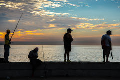 Group of friend fishing at Malecon,  in Havana, Cuba. Stock Images