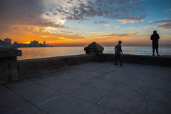 Group of friend fishing at Malecon,  in Havana, Cuba. Havana, Cuba - September 25, 2015: Group of friend fishing at sunset at Malecon,  most popular and famous Stock Images