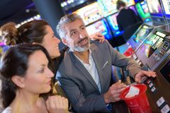 Group friend playing with slot machines. Group of friend playing with slot machines Stock Image