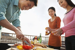 Group of Friend Preparing for a Barbecue on a Rooftop Royalty Free Stock Photo