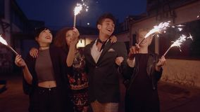 Group of friend with sparklers on city street stock footage