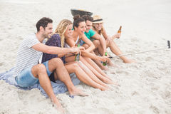 Group of friend taking a selfie on the beach Royalty Free Stock Image