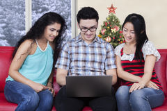 Group of friend using laptop at home Royalty Free Stock Images
