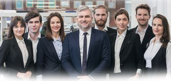 Group of friendly businesspeople. With male mature leader in office Royalty Free Stock Image