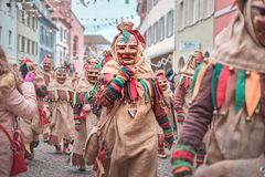 Group of friendly carnival figures at a street party. Carnival in southern Germany - Black Forest stock photos
