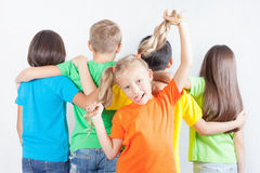 Group of friendly childrens like a team together. Funny girl holds her tail hair. Friendship. Kids. Education, school. Fun Stock Images