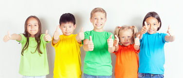 Group of friendly childrens like a team together. Successful young people shows thumb up gesture. Success. Friendship. Kids. Conceptual image Stock Photos