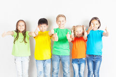 Group of friendly childrens like a team together. Successful young people shows thumb up gesture. Success. Friendship. Kids. Conceptual image Stock Images