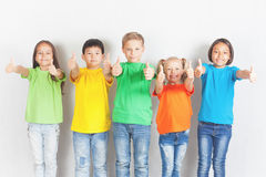 Group of friendly childrens like a team together. Successful young people shows thumb up gesture. Success. Friendship. Kids. Conceptual image Royalty Free Stock Photo