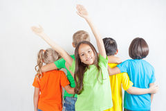 Group of friendly childrens like a team together. Summer vacation, camp, holidays. Healthy lifestyle. Funny asian girl hands up. Friendship. Kids. Education Royalty Free Stock Photos