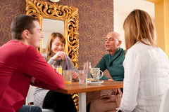 Group of friends on afternoon coffee. In a bar Royalty Free Stock Image
