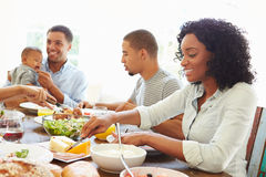 Group Of Friends With Babies Enjoying Meal At Home Together Royalty Free Stock Photography