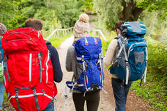 Group of friends with backpacks hiking Royalty Free Stock Photo