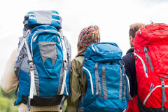 Group of friends with backpacks hiking Stock Images