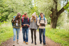 Group of friends with backpacks and tablet pc Stock Images