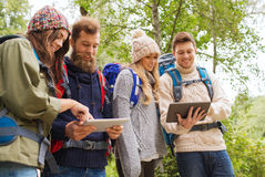 Group of friends with backpacks and tablet pc Stock Image